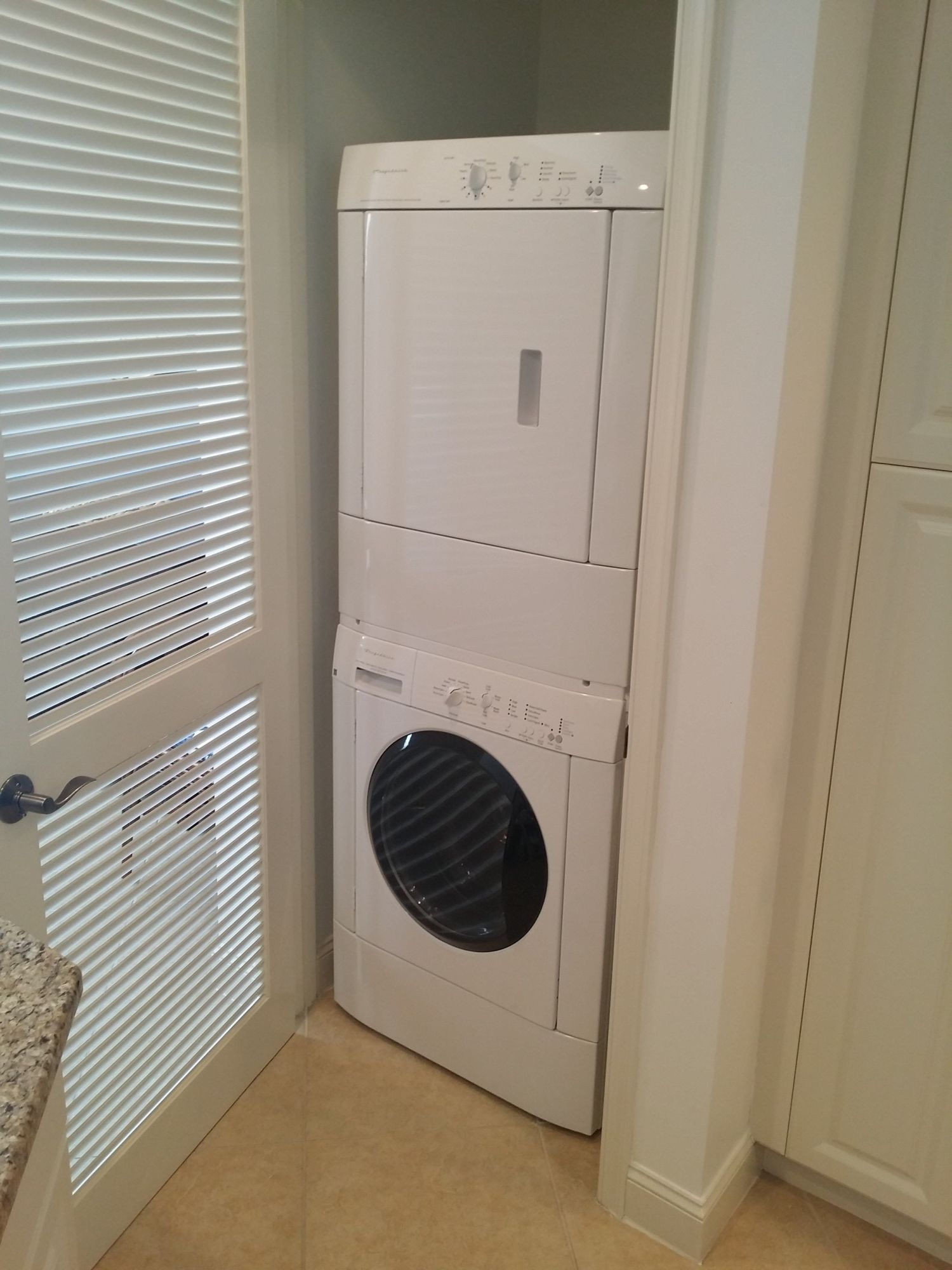 In Residence Laundry with Stackable Washer and Dryer. Located in the Kitchen.